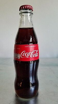 """COCA-COLA MEXICO """"SABOR ORIGINAL"""", FULL 235ml RED LABEL CLEAR GLASS BOTTLE."""