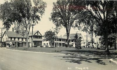 Troy New Hampshire~Shops~Coca-Cola Signs~Homes~Across Park~1930s Car~RPPC Photo