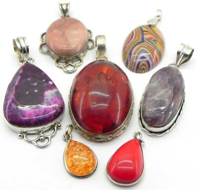 Collection of Silver Pendants.