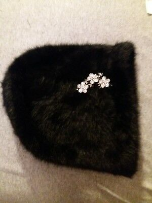 M&S ladies black soft fury hat with beautiful crystal flowers.