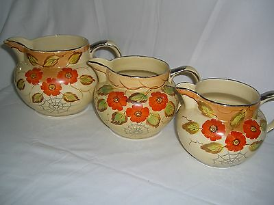 Arthur Wood Spider Webb Pattern Graduated Trio Of Jugs In Good Condition