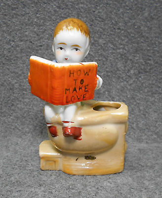 """Vintage Figurine of Boy on Toilet Reading Book """"How to Make Love"""" - Made Japan"""