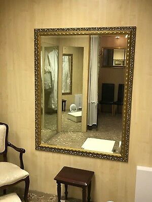 Large wall mirror with bevel edge and decorative border