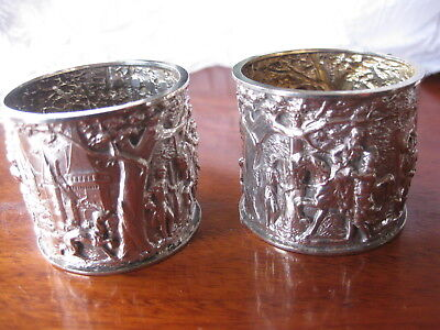 Pair of silver napkin rings embossed with medieval scenes. Hall marked