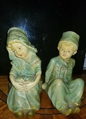 Dutch boy and girl porcelain with clogs sitting down