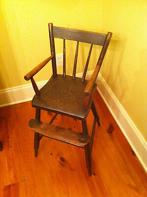 Antique child's youth high chair in original used condition.