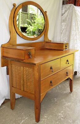 Antique dressing table with oval mirror.