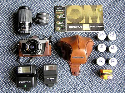 OLYMPUS OM 1N 35 mm SLR CAMERA BUNDLE, WITH EXTRA LENSES AND FLASHES