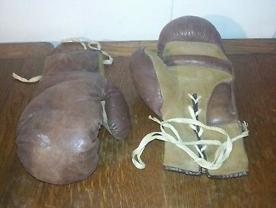 Vintage brown and tan leather lace up boxing gloves