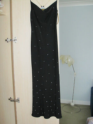 Austin Reed ladies' black evening dress with silver decoration and gold lining.