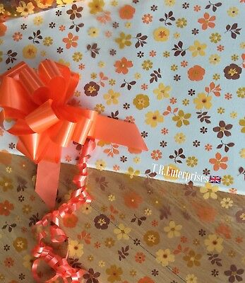 1metre X 80cm Autumnal scattered Flowers Cellophane/ 30mm Pull Bow. Astic Group