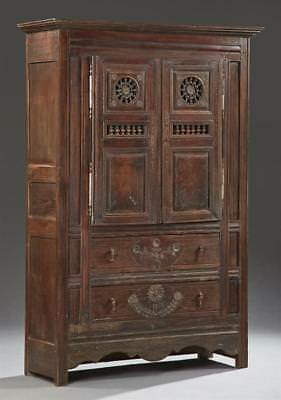 French Provincial Carved Oak Armoire, 19th c., Brittany, the stepped ... Lot 824