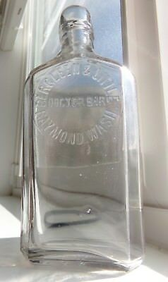 Western Whiskey Flask, bergleen & little, Raymond, Wash. Liquor Store Washington