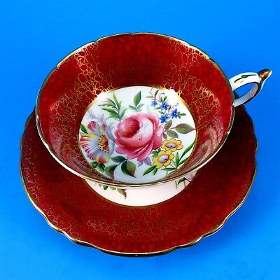 Stunning Deep Red with Gold and Rose Floral Center Paragon Tea Cup and Saucer
