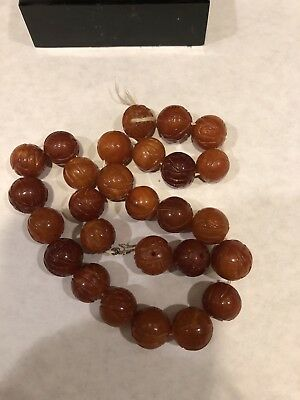 27 Antique Carved Amber Beads.  Beautiful.