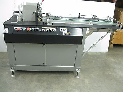 Kirk-Rudy Model 215V Shuttle Feed Base Labeler System (EC)
