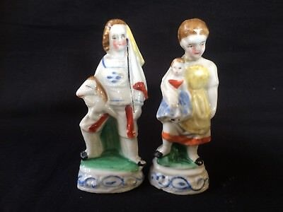 antique porcelain pair of very old french miniature figurines. Boy and girl