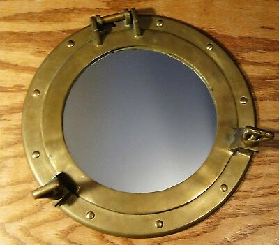 Vintage solid brass maritime nautical porthole window mirror, works, nice patina