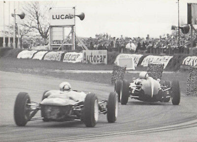 Lotus ? Single Seater Behind Another Single Seater Racing Car Photograph.