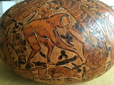 Old fruit carved with lots of animals and characters