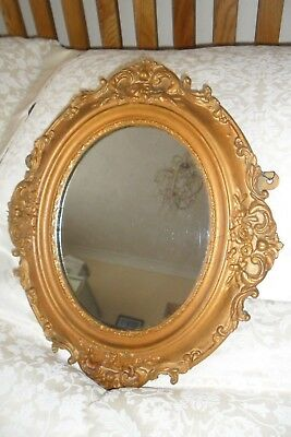Antique Oval Gilt Framed Mirror.