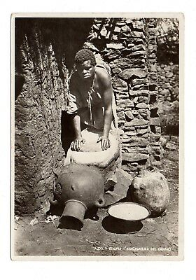 ETHIOPIA, AFRICA, NATIVE AT WORK GRINDING GRAIN, REAL PHOTO PC c 1920-30's