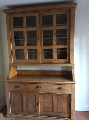 Stunning and unusual antique large pine dresser with sliding doors.