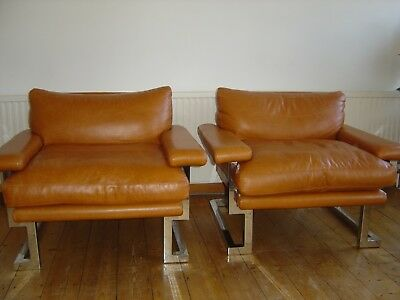 Pair of matching Pieff leather armchairs