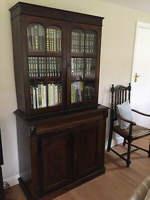 Oak Victorian cupboard and book case with draw.