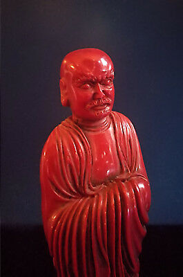 Antique Chinese Red Lacquer Figure of an Immortal, ca. 1900, 17 cm high.