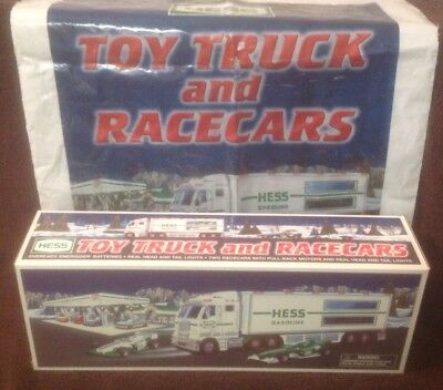 2003 Hess Toy Truck and Racecars NIB with matching Hess Toy Truck bag.