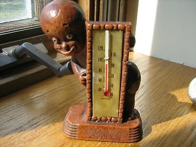 little black boy holding a thermometer