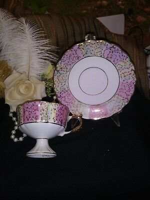 Pink stripe,Iridescent,Beautiful Vintage Tea cup and saucer set. No Flaws