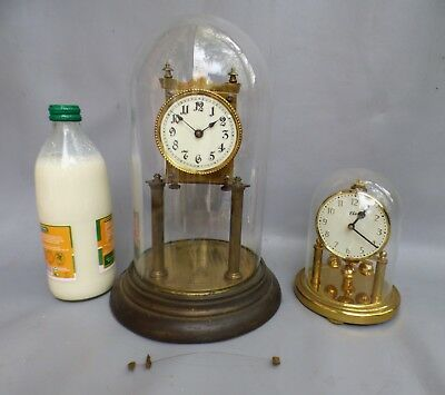 A Early Enamel Faced Torsion Clock And A Haller Elo Anniversary Clock