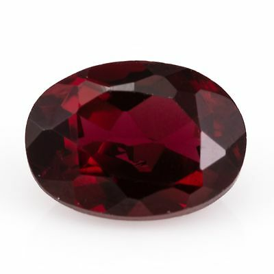1.22ct Almandine Garnet. An oval cut, grape purple gem with flashes of red.