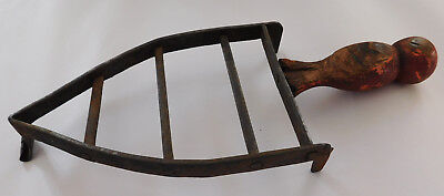 Antique iron rest stand trivet Wooden handle Victorian laundry equipment