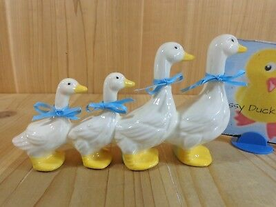 DUCKS IN A ROW FIGURINE Family of 4 Walking Porcelain Blue Bows White Geese
