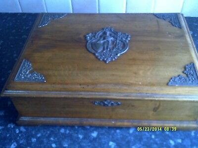 Antique Wooden  writing box with a metal decoration of a knight on the top
