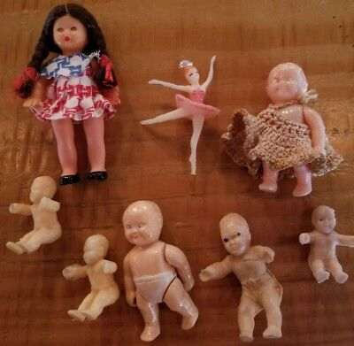 lot of vintage small creepy crafty celluloid plastic rubber dolls