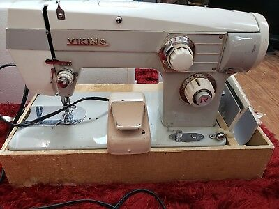Eaton retire VIKING WHITE DOMESTIC SEWING MACHINE WITH A CASE..