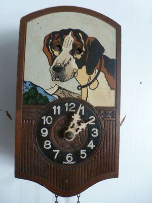 Rare small German black forest automaton moving eyes  wall clock