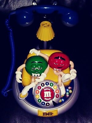 M&M ANIMATED Talking Light-Up Phone with Red and Green m&m's.on Couch