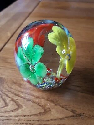 Small Glass Paperweight Yellow Orange And Green Flowers Slightly Oval In Shape