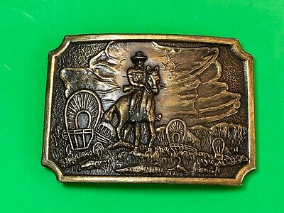 Vintage Cowboy riding horse Trails -  out west with covered wagons Belt Buckle