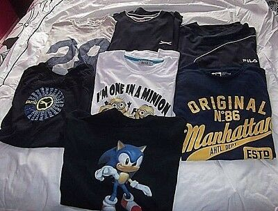 A Small Lot of  7 large t shirts