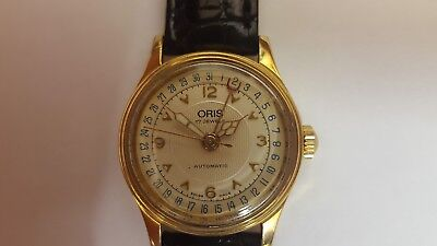 Ladies Oris 7405 Automatic Gold Plated Wrist Watch with a Black Leather Strap
