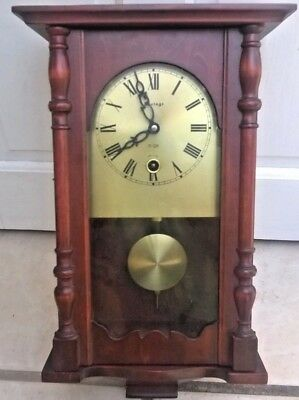 Vintage chiming wall clock, with winding key. Vintage manufacturer.