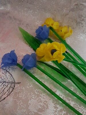 A Bunch Of Glass Flowers