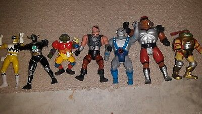 lot of action figures Thunder cats, tmnt, power rangers.