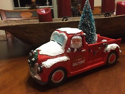 vintage old red truck with santa christmas tree and presents north pole delivery